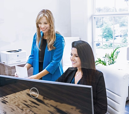 two women performing a title search and exam at south oak title and closing